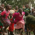 Livingstone African Safaris – Landing Page – Children Dancing – Blue Sky Wildlife