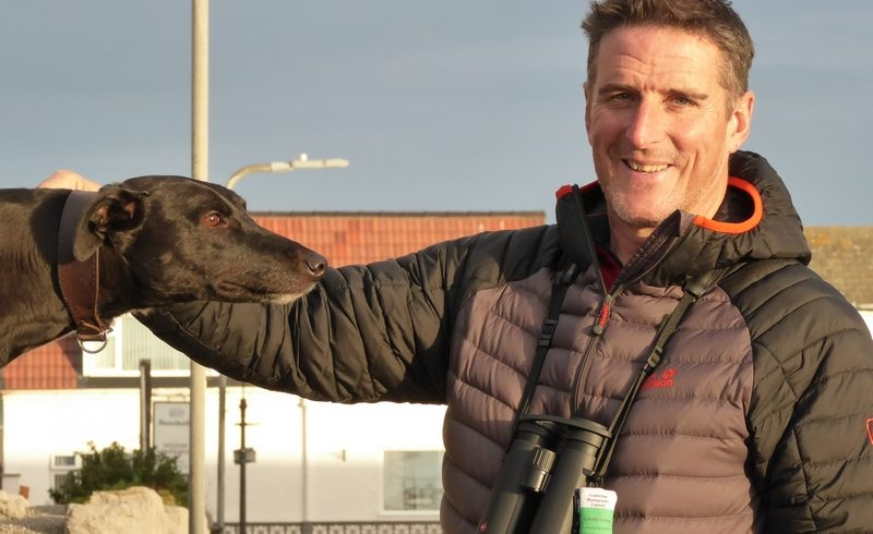 Iolo Williams pats head of dog in North Wales