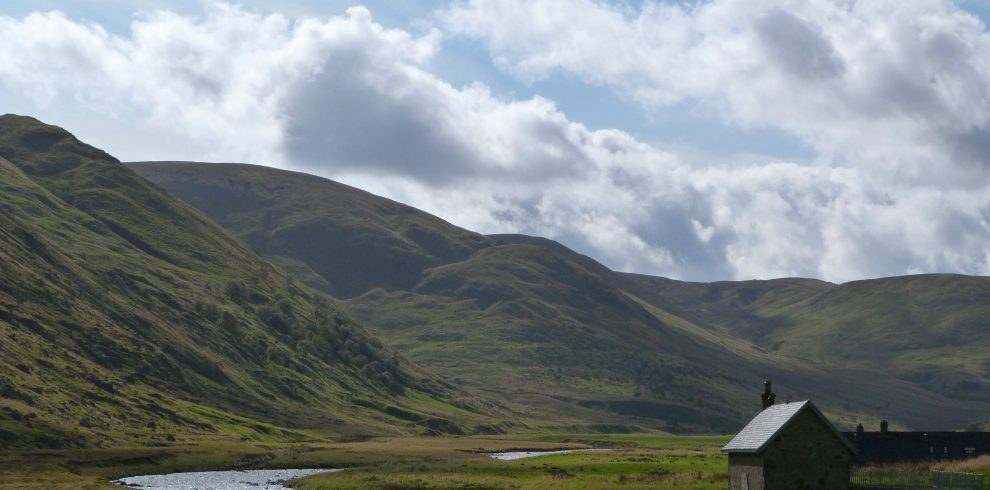 Strathdearn mountains in Findhorn Valley with hut in Scottish Highlands
